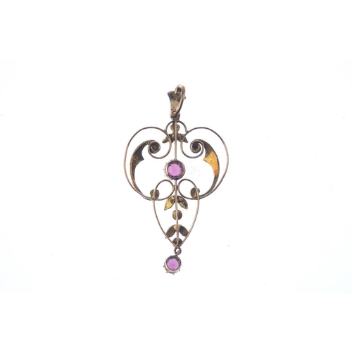 206 - An Edwardian 9ct gold garnet and split-pearl pendant. The circular-shape garnet, suspended from a sp...