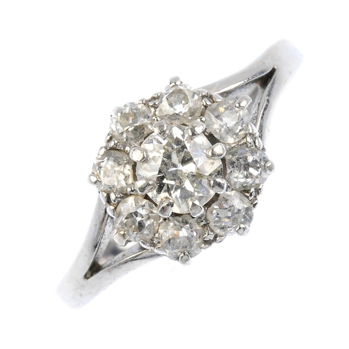 208 - A diamond cluster ring. The old-cut diamond, within a similarly-cut diamond surround, with openwork ...