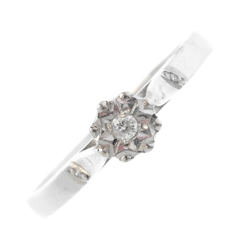 210 - An 18ct gold diamond single-stone ring. The brilliant-cut diamond, with single-cut diamond shoulders...