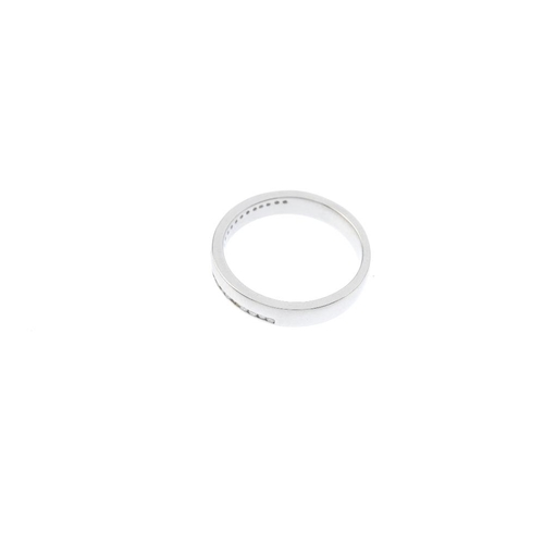 213 - A platinum diamond half-circle eternity ring. Designed as a wide band, with two brilliant-cut diamon...