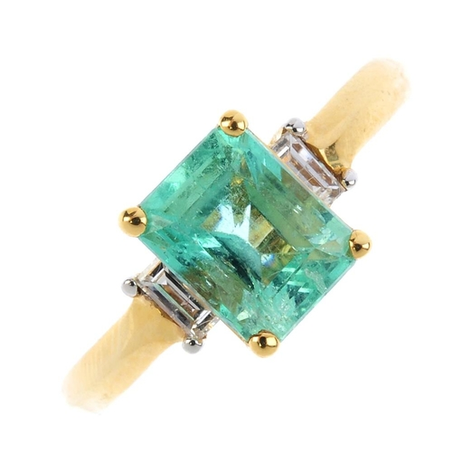 217 - An 18ct gold emerald and diamond three-stone ring. The rectangular-shape emerald, with baguette-cut ...