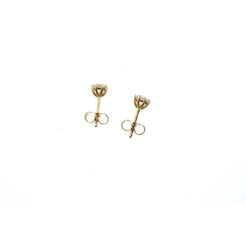 219 - A pair of 18ct gold brilliant-cut diamond stud earrings. Estimated total diamond weight 0.60ct, H-I ...