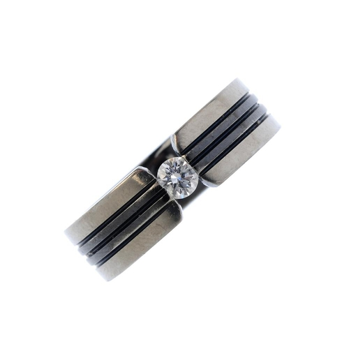 223 - A diamond band ring. The brilliant-cut diamond, with a bi-colour grooved band. Estimated diamond wei...
