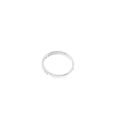 224 - A 9ct gold diamond half-circle eternity ring. The brilliant-cut diamond line, to the plain band. Est...