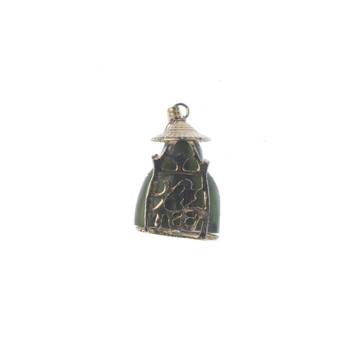 225 - A jade pendant. Designed as a nephrite carving of a seated figure, with hat surmount and oriental ch...
