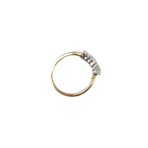 229 - An 18ct gold diamond ring. The brilliant-cut diamond curved line, with plain band. Estimated total d...