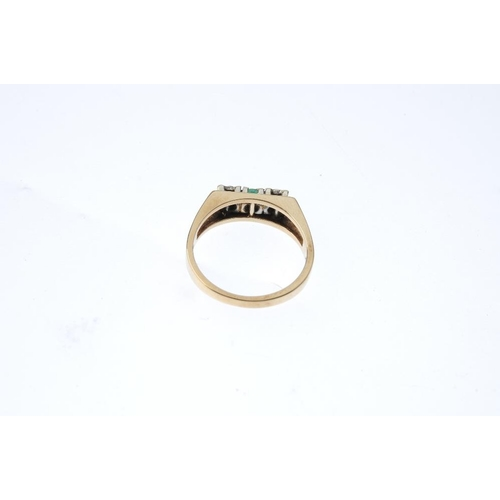 230 - A 9ct gold emerald and diamond three-stone ring. The circular-shape emerald, with single-cut diamond...
