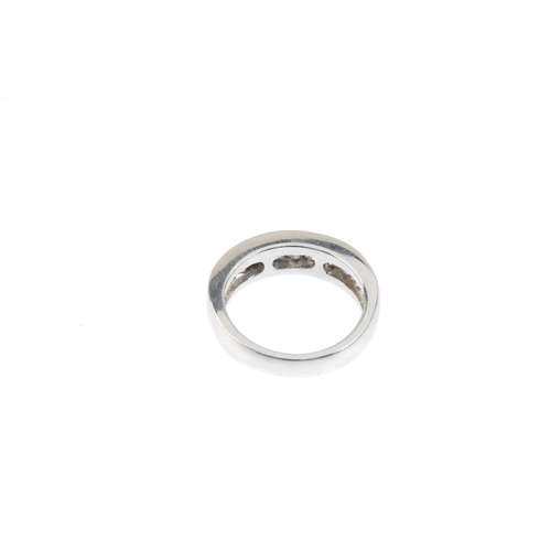 233 - A platinum diamond half-circle eternity ring. Designed as an alternating square and rectangular-shap...