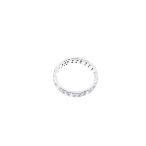 234 - An 18ct gold diamond full-circle eternity ring. Comprising two brilliant-cut diamond lines, with gro...