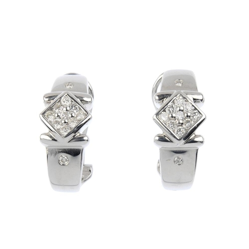 238 - A pair of 18ct gold diamond earrings. Each designed as a pave-set diamond kite-shape panel, with bar...