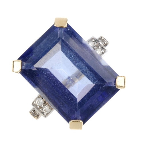 241 - A 9ct gold coated quartz and diamond dress ring. The rectangular-shape blue coated quartz, with bril...