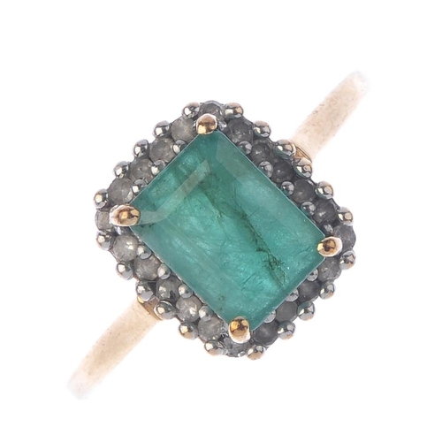 242 - A 9ct gold emerald and diamond cluster ring. The rectangular-shape emerald, within a single-cut diam...