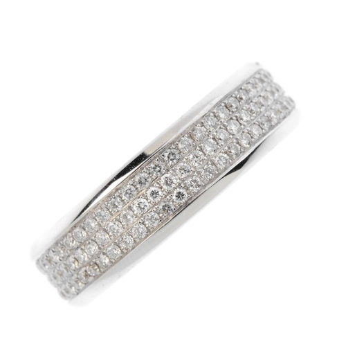 243 - An 18ct gold diamond full-circle eternity ring. The pave-set diamond band, with polished sides. Esti...