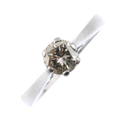 247 - A diamond single-stone ring. The brilliant-cut diamond, with tapered shoulders and plain band.  Esti...