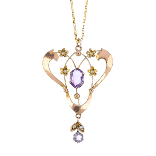 248 - An early 20th century 9ct gold amethyst pendant. Of openwork design, the oval-shape amethyst, with a...