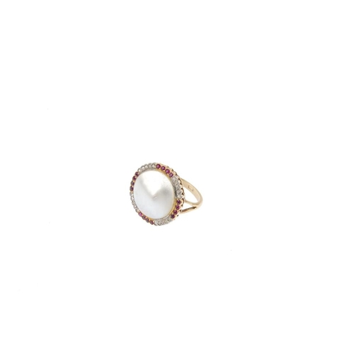250 - A gem-set dress ring. The blister-pearl, within a circular-shape ruby and rose-cut diamond scalloped...