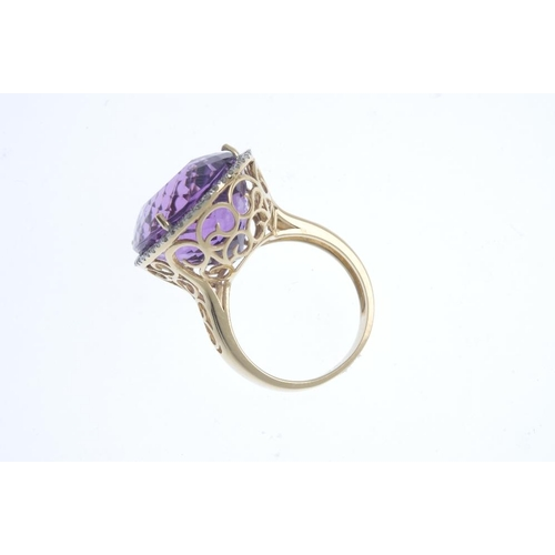 254 - An amethyst and diamond dress ring. The oval-shape amethyst, with brilliant-cut diamond surround and...