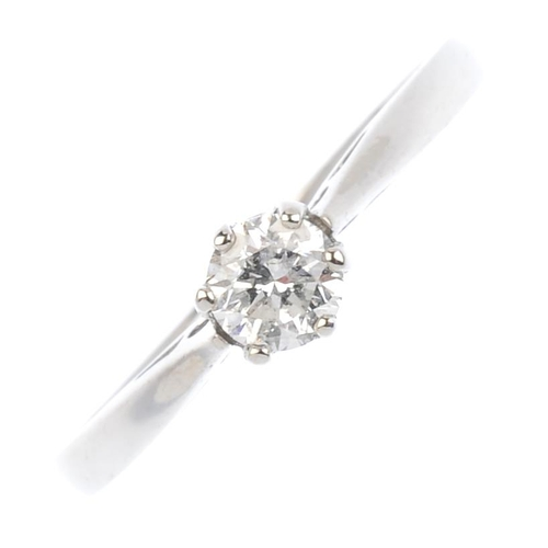 256 - An 18ct gold diamond single-stone ring. The brilliant-cut diamond, with tapered shoulders. Diamond w...