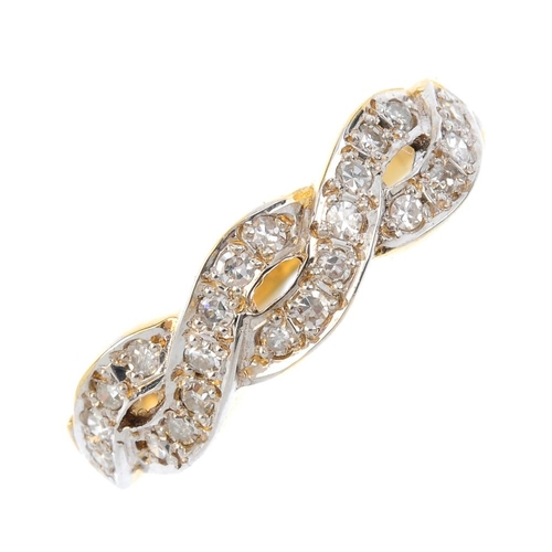 259 - An 18ct gold diamond dress ring. The single-cut diamond overlapping lines, with tapered shoulders. E...