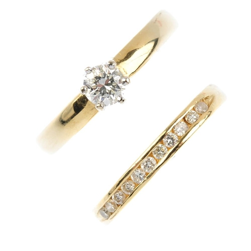 260 - Two diamond rings. To include a diamond single-stone ring, together with a similarly-cut diamond hal...