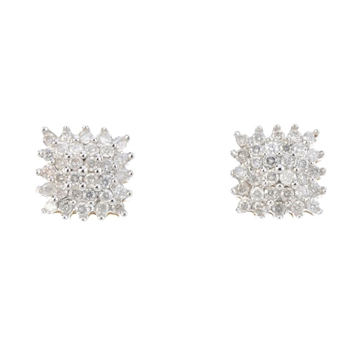 263 - A pair of diamond cluster earrings. Each designed as a brilliant-cut diamond square-shape stepped cl...