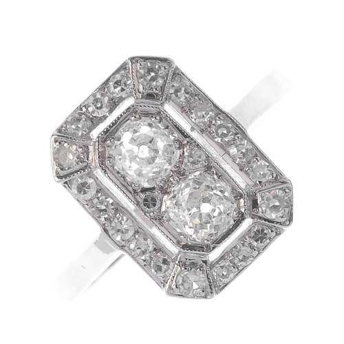 264 - A diamond dress ring. Designed as an old-cut diamond duo, with single-cut diamond surround and plain...