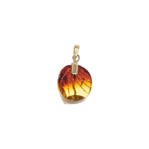270 - A 9ct gold modified amber pendant and a bracelet. The pendant designed as oval-shape modified amber ...