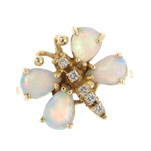 271 - An opal diamond dress ring. Designed as a butterfly, with pear-shape opal cabochon wings, and brilli...