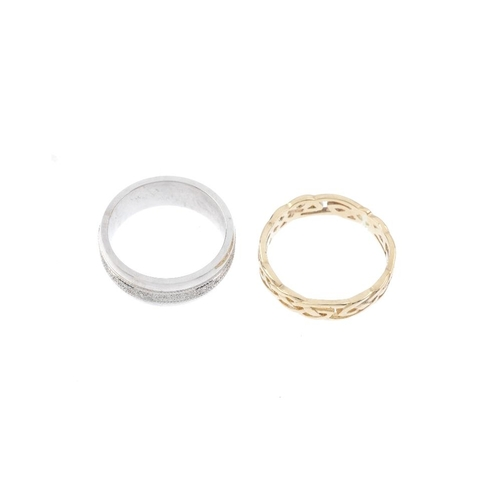 272 - Two 9ct gold band rings. The first of openwork design, the second designed as a textured band with p...