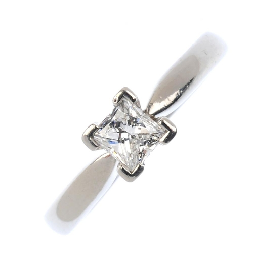 274 - An 18ct gold diamond single-stone ring. The square-shape diamond, with tapered shoulders. Diamond we...