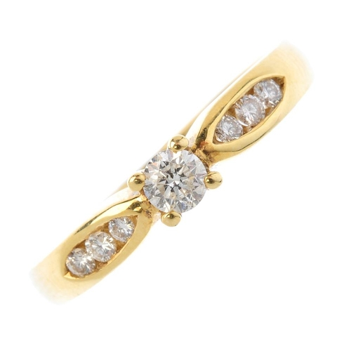 278 - An 18ct gold diamond single-stone ring. The brilliant-cut diamond, with similarly-cut diamond line s...