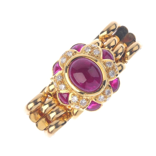 279 - A ruby and diamond ring. The oval ruby cabochon, within a brilliant-cut diamond and fancy-shape ruby...