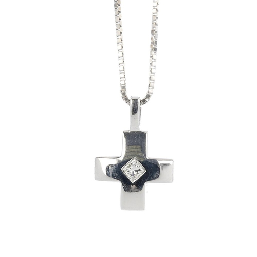 28 - An 18ct gold diamond cross pendant. The square-shape diamond, inset to the polished cross, suspended...