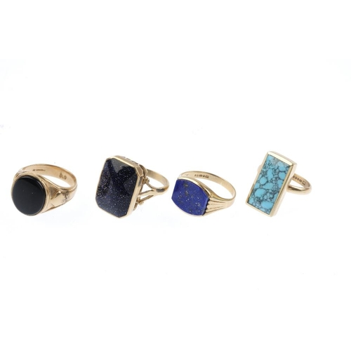 280 - Four 9ct gold gem-set rings. To include a lapis lazuli panel ring, a onyx panel ring, a blue goldsto...