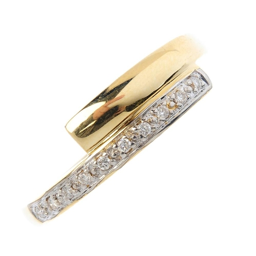 281 - An 18ct diamond band ring. Of crossover design, the band with brilliant-cut diamond and polished ter...