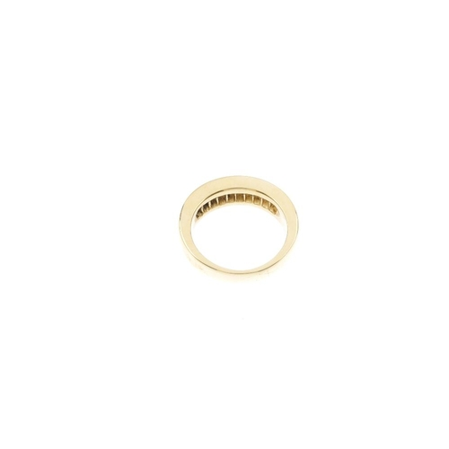 284 - An 18ct gold diamond half-circle eternity ring. The square-shape diamond line, inset to the plain ba...