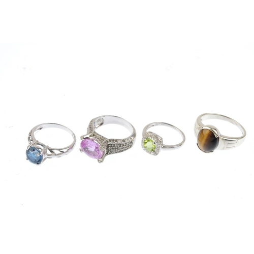 285 - Four diamond and gem-set rings. To include a 9ct gold peridot and diamond cluster ring, a 9ct gold b...