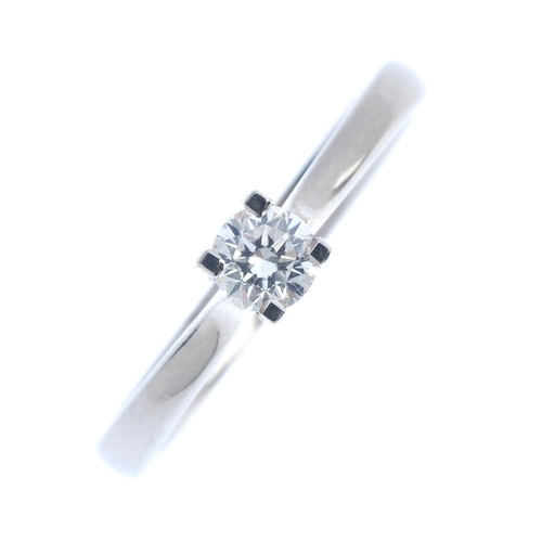 287 - A platinum diamond single-stone ring. The brilliant-cut diamond, with tapered shoulders and plain ba...