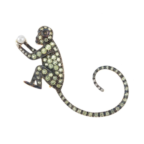 288 - A monkey brooch. The circular-shape yellow gem monkey, grasping a cultured pearl. Length 4.6cms, <br...