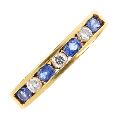 290 - An 18ct gold diamond and sapphire half-circle eternity ring. The alternating circular-shape sapphire...