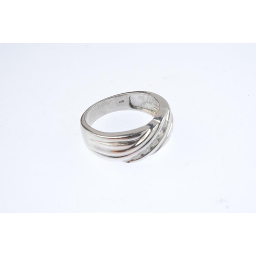 291 - A diamond dress ring. The brilliant-cut diamond line, inset to the grooved, crossover band. Total di...