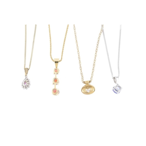 293 - Five gem-set pendants. To include a ruby and diamond cluster pendant, suspended from a 9ct gold curb...