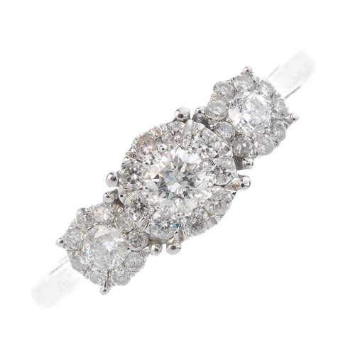 295 - A 9ct diamond triple cluster ring. The brilliant-cut diamond floral cluster, with similarly designed...