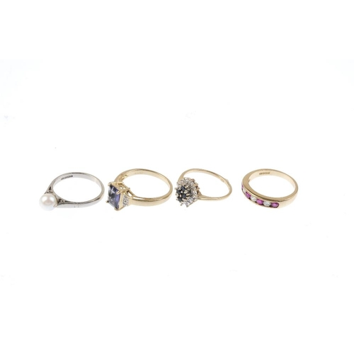 296 - Four 9ct gold diamond and gem-set rings. To include a ruby and diamond half-circle eternity ring, a ...