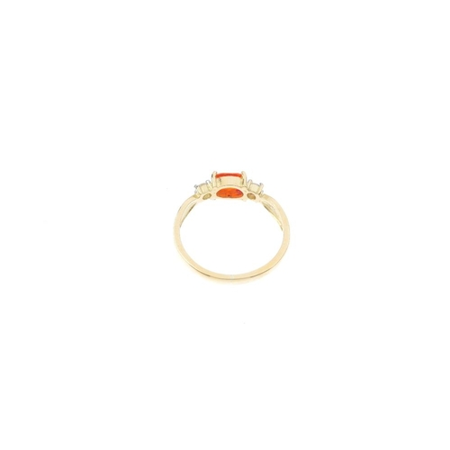 3 - An 18ct gold fire opal and diamond three-stone ring. The oval-shape fire opal, with brilliant-cut di...