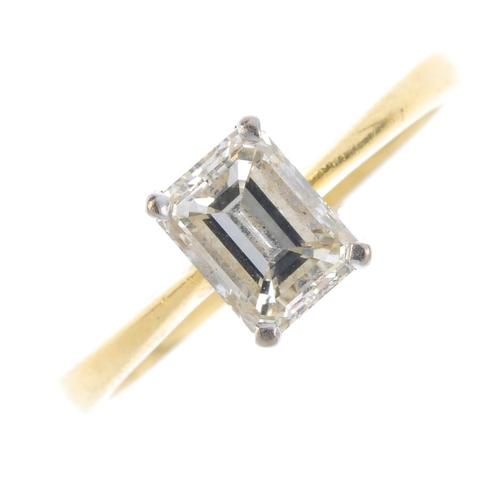 30 - An 18ct gold diamond single-stone ring. The rectangular-shape diamond, with bi-colour gallery and ta...