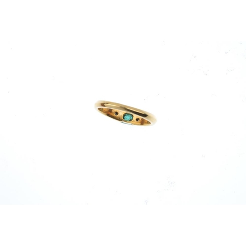 303 - An 18ct gold emerald and diamond three-stone ring. The rectangular-shape emerald, with square-shape ...
