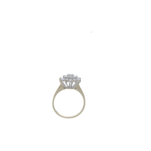 314 - An 18ct gold diamond cluster ring. Of hexagonal outline, the brilliant-cut diamond, within a similar...