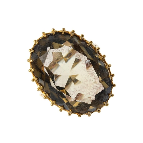 318 - A 9ct gold smoky quartz single-stone ring. The oval-shape smoky quartz, with an openwork gallery set...