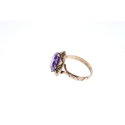 325 - A synthetic colour-change sapphire single-stone ring. The circular-shape colour-change synthetic sap...